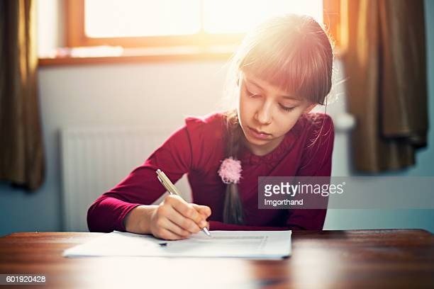 Little girl taking test at home