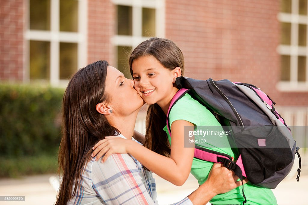 Little Girl Tells Mom Goodbye On First Day Of School Stock Photo