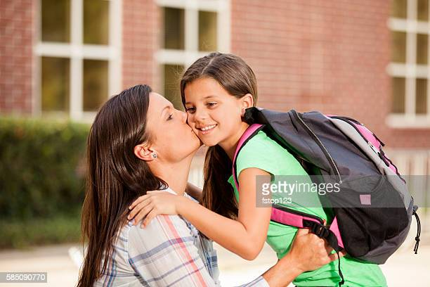 Little girl tells mom goodbye on first day of school.