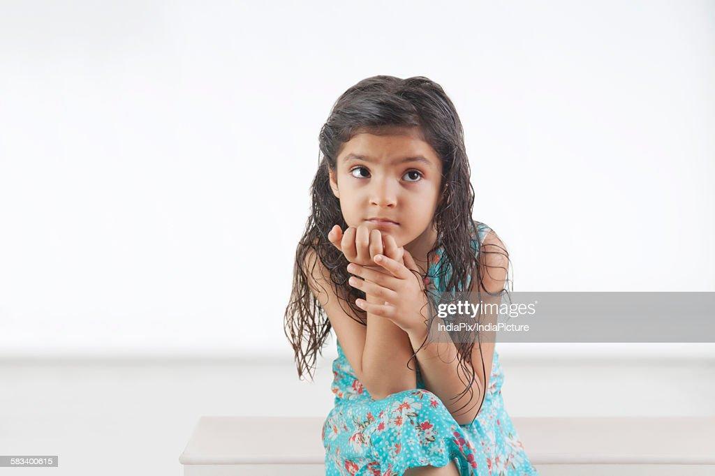 Little girl thinking : Stock Photo