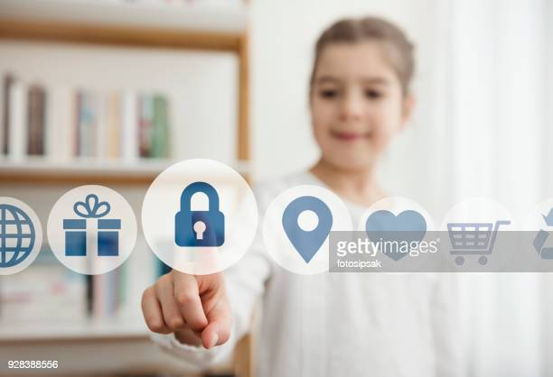 little girl touching the security button on the digital screen - safety stock pictures, royalty-free photos & images