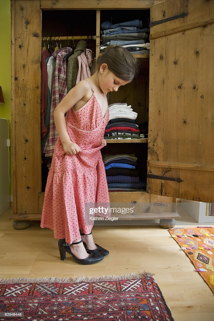 Little Girl Trying On Her Mothers Shoes And Dress Stock Photo  Getty Images-9082