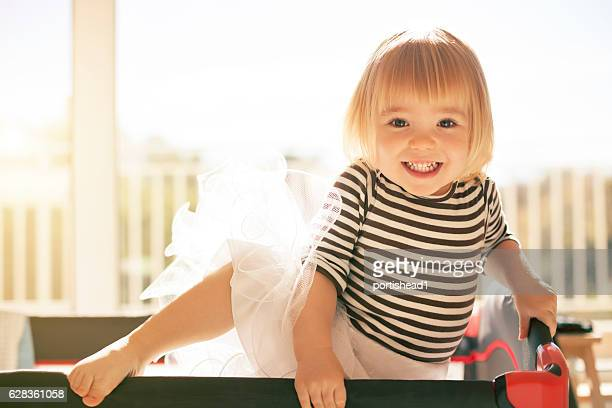little girl trying to leave the crib - rymma bildbanksfoton och bilder