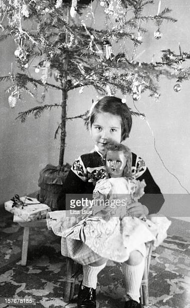 Little Girl under Christmas Tree in 1958.Black And White