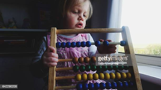 Little girl using an abacus