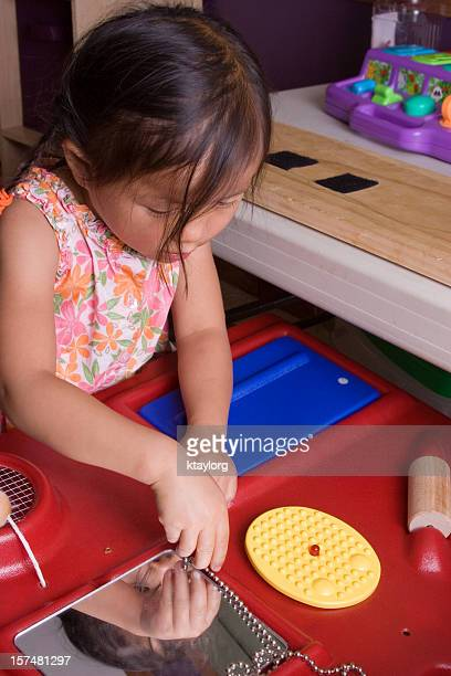 Little girl using sensory station during therapy