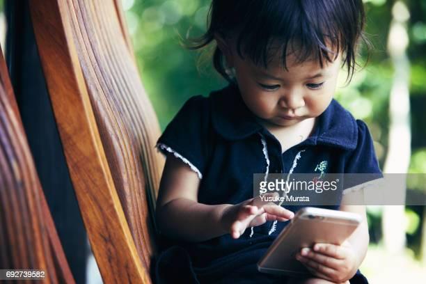 Little girl using smartphone