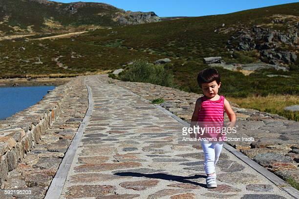Little girl walking down a path