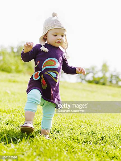 Little Girl Walking Down Grassy Hill