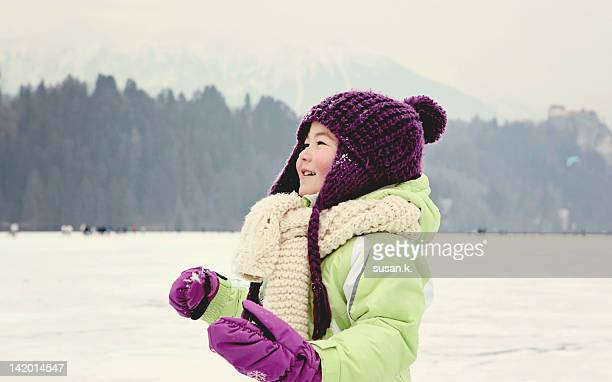 Little girl walking on frozen lake