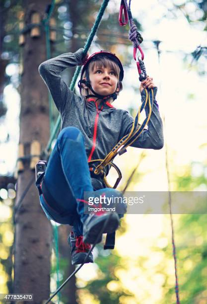 little girl walking on line in ropes course adventure park - imgorthand stock photos and pictures