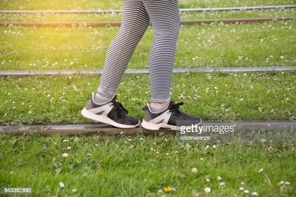 Little girl walking on the tracks of a tram