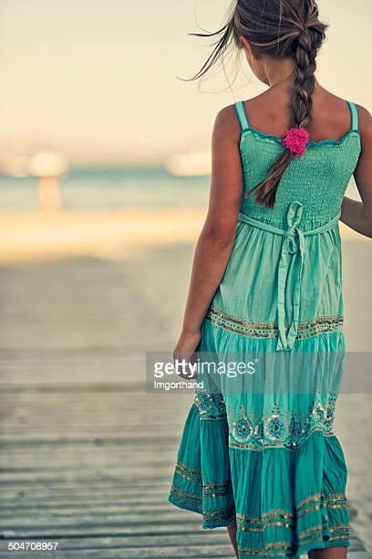 Little girl walking to a beach