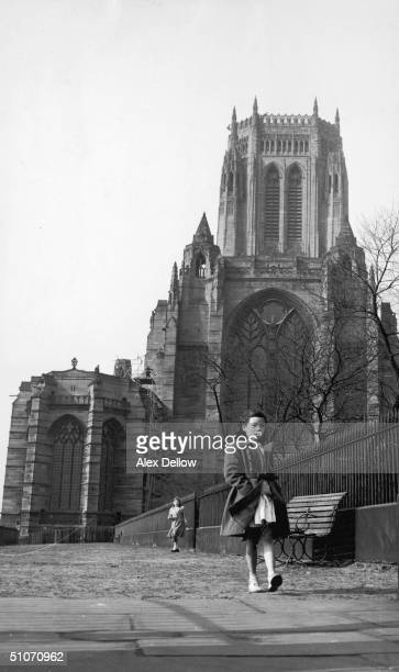 A little girl walks past the Anglican cathedral in Liverpool designed by Sir Giles Gilbert Scott June 1955 Original Publication Picture Post 7795...