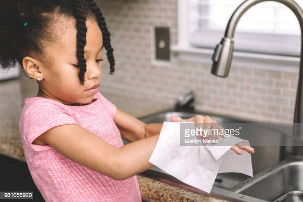 little girl washing her hands - kitchen paper stock pictures, royalty-free photos & images