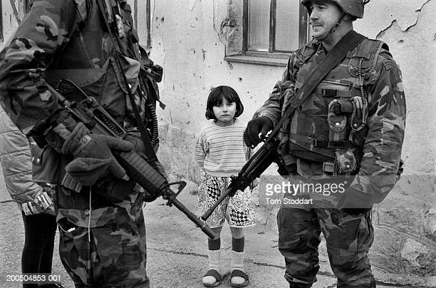 Bosnia Sarajevo April 1996 A little girl watches heavily armed US Special Forces on patrol in Sarajevo after the ceasefire During the 47 months...