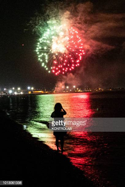 SCHIAVONEA CORIGLIANO CALABRIA ITALY A little girl watches the fireworks by the sea during the summer party for Santa Maria Ad Nives held in...