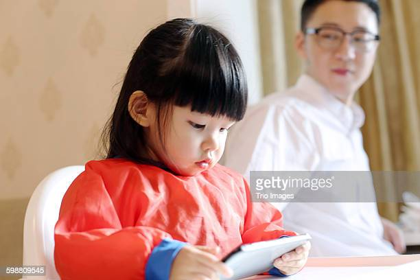 little girl watching cartoon on mobile phone
