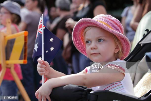 little girl waving an australian flag - anzac day stock pictures, royalty-free photos & images