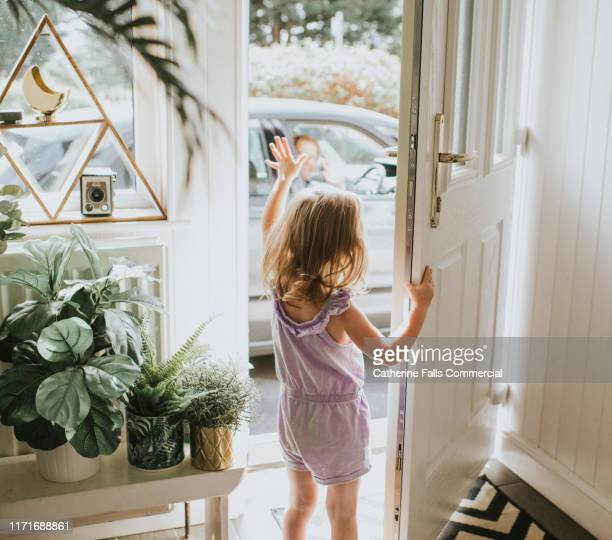 little girl waving - waving stock pictures, royalty-free photos & images