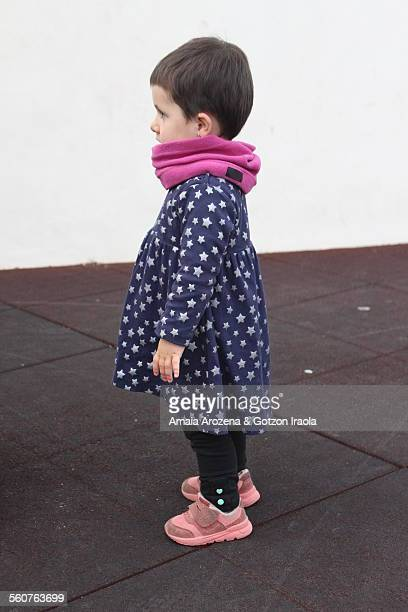 Little girl wearing a dress stars