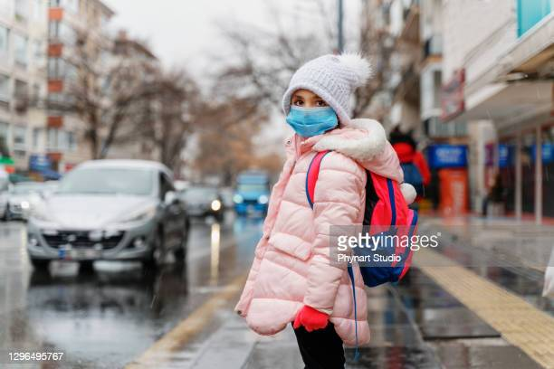 little girl wearing anti virus masks going to school - education stock pictures, royalty-free photos & images