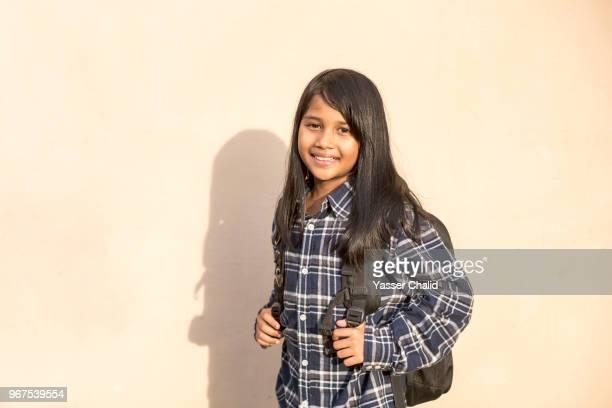Little Girl Wearing Backpack For School
