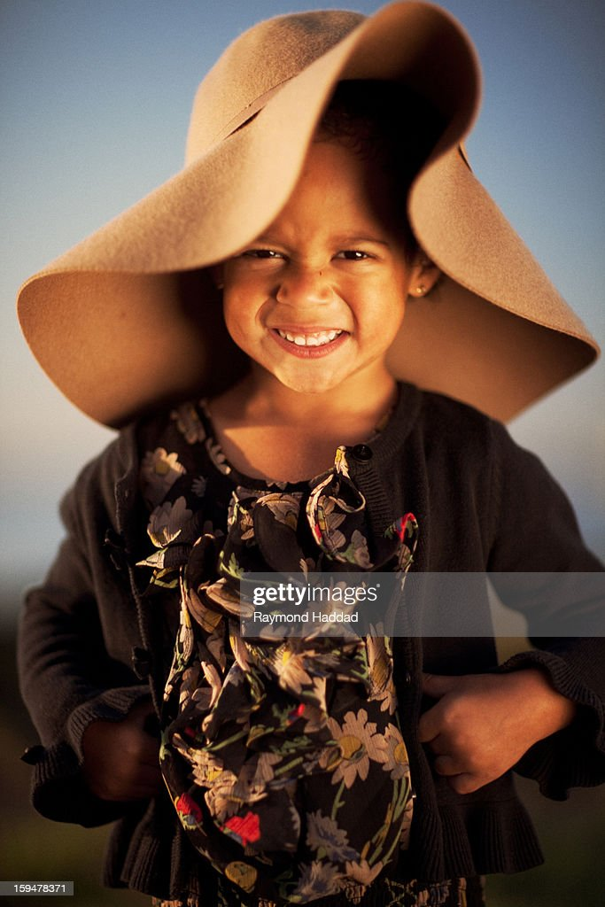 df64260f501 Little Girl Wearing Big Floppy Hat   Stock Photo