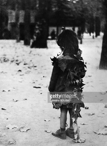 Little Girl Wearing Dead Leaves In The Garden Of Luxembourg . The First Of Edouard Boubat'S Pictures.
