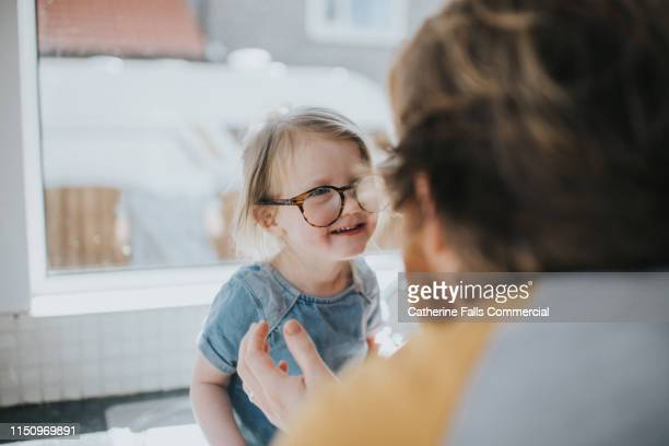 little girl wearing glasses - daughter stock pictures, royalty-free photos & images