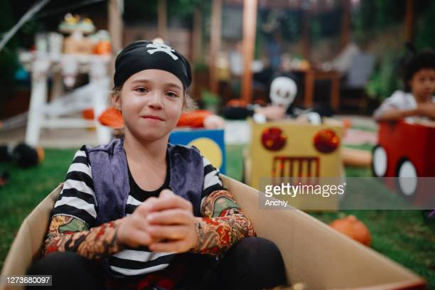 little girl wearing halloween costume and keeping social distance during outdoor halloween party - scaredastronaut stock pictures, royalty-free photos & images