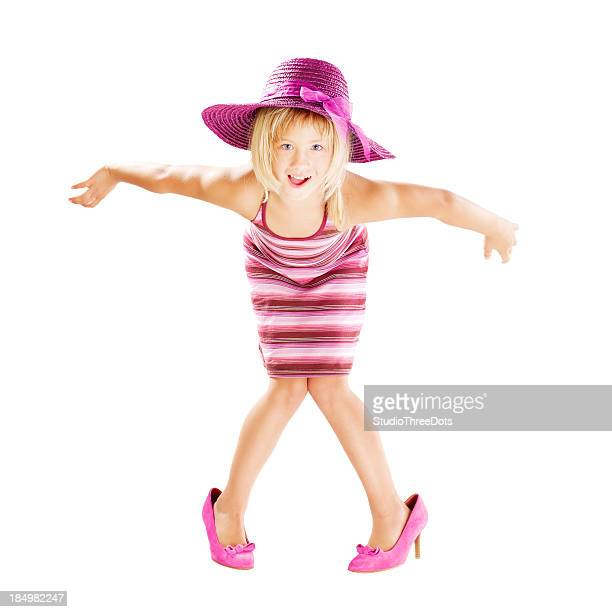 little girl wearing hat and big shoes