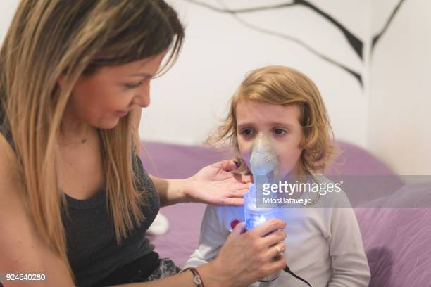 little girl wearing inhaling mask - respiratory disease stock pictures, royalty-free photos & images