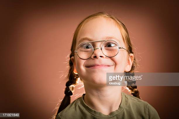 little girl wearing nerdy glasses and making silly face - girl nerd hairstyles stock photos and pictures