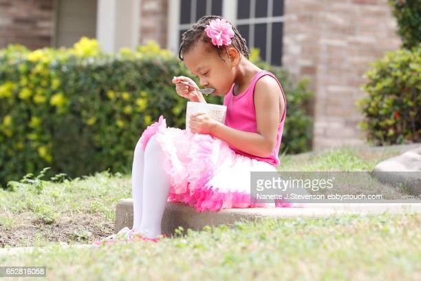 little girl wearing pink tutu with coffee and computer - nanette j stevenson stock photos and pictures