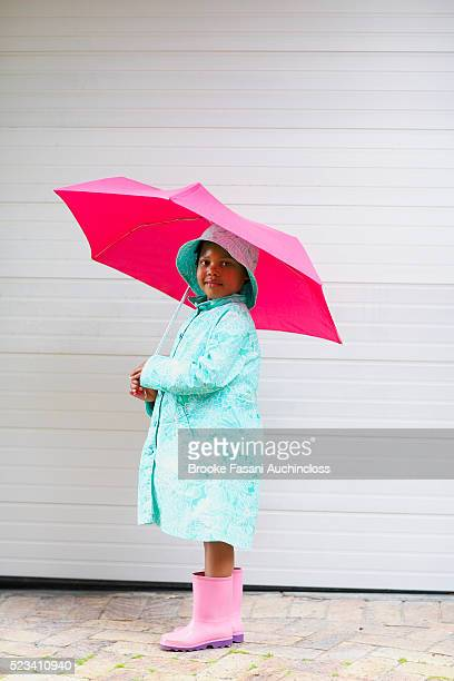 little girl wearing rain gear - vintage raincoat stock pictures, royalty-free photos & images
