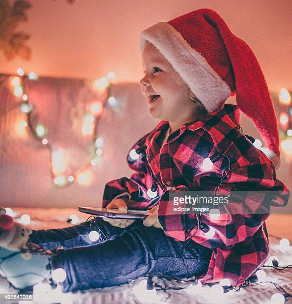 little girl wearing santa hat - santa face stockfoto's en -beelden