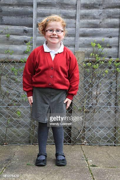 little girl wearing school uniform - school uniform stock photos and pictures