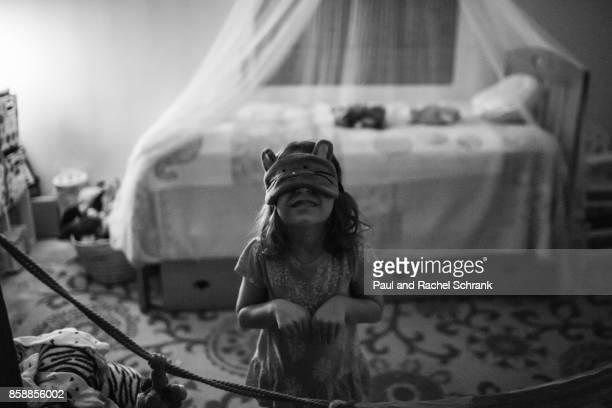 Little Girl Wearing Sleep Mask Pretending to be a Cat