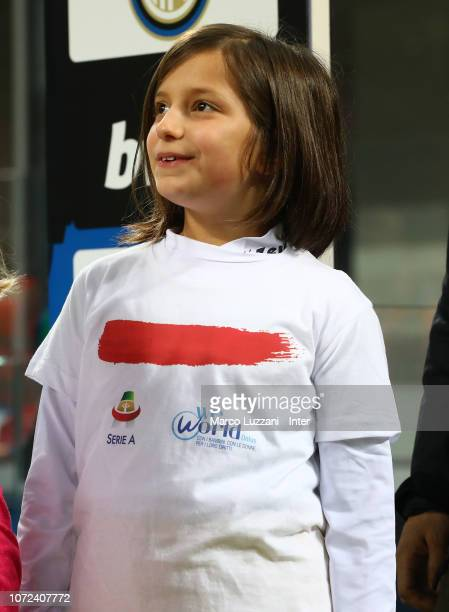 Little girl wears a shirt to support the campaign Un Rosso Alla Violenza #unrossoallaviolenza before the Serie A match between FC Internazionale and...