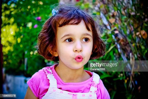 little girl whistles outside
