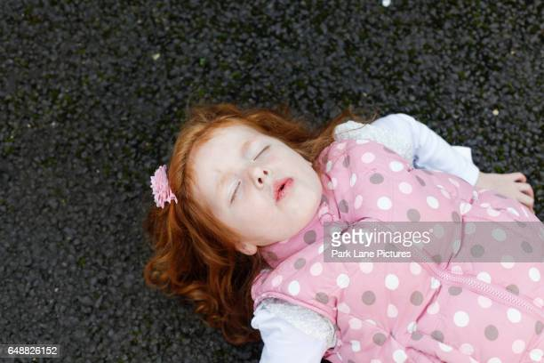little girl who has fallen on her back - who stock pictures, royalty-free photos & images