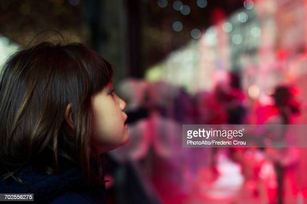 Little girl window shopping