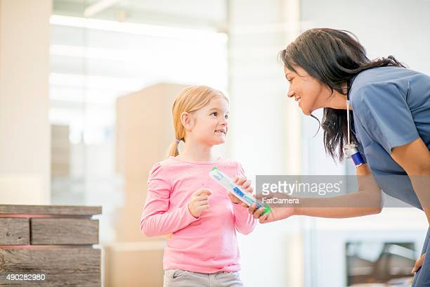Little Girl With a Dental Assistant