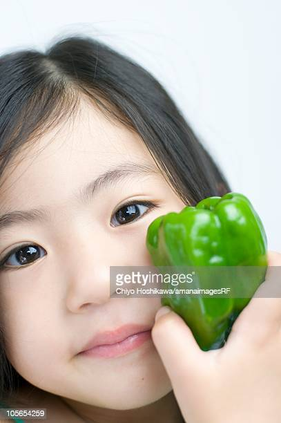 little girl with a green capsicum - green bell pepper stock pictures, royalty-free photos & images