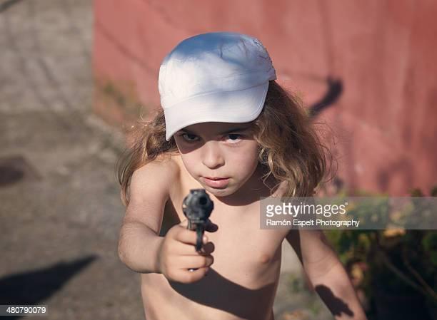 Little girl with a pop gun
