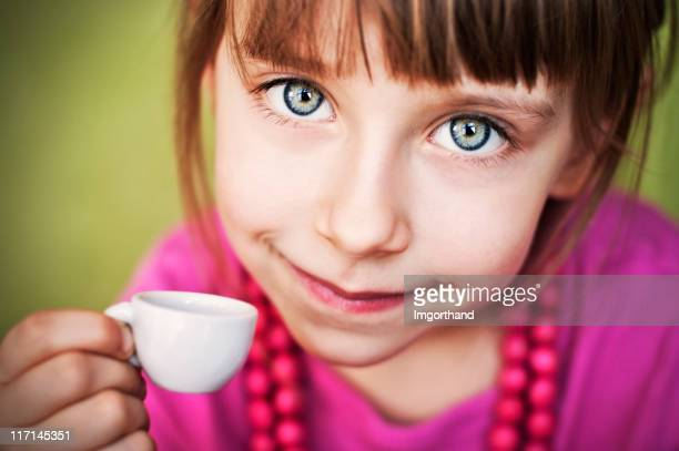 little girl with a tiny cup - imgorthand stock photos and pictures