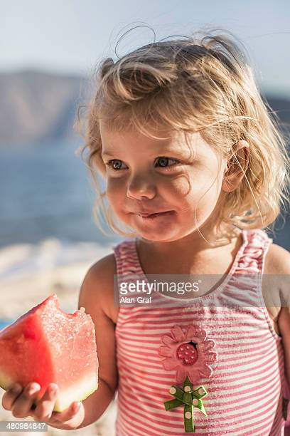 Little girl with a watermelon slice