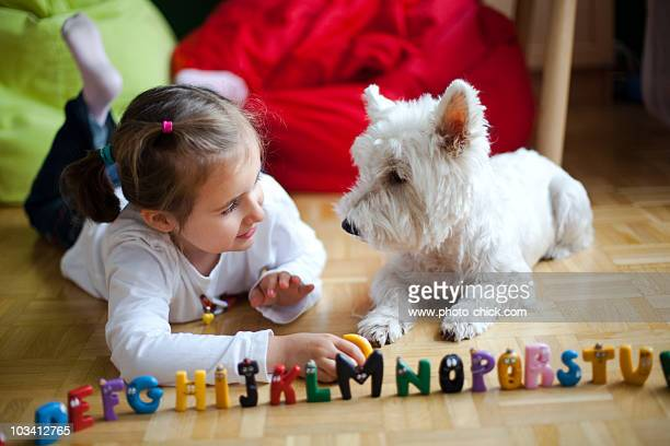 Little girl with a white dog