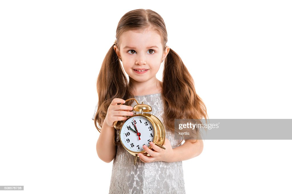 little girl with alarm clock (isolated on white background, isolated) : Stockfoto